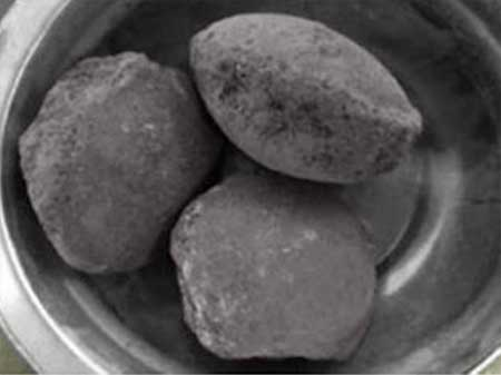 newly made dust briquette from roll press