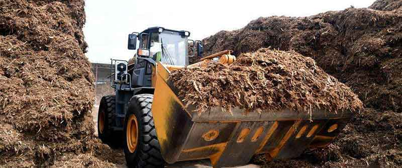 biomass waste in loader